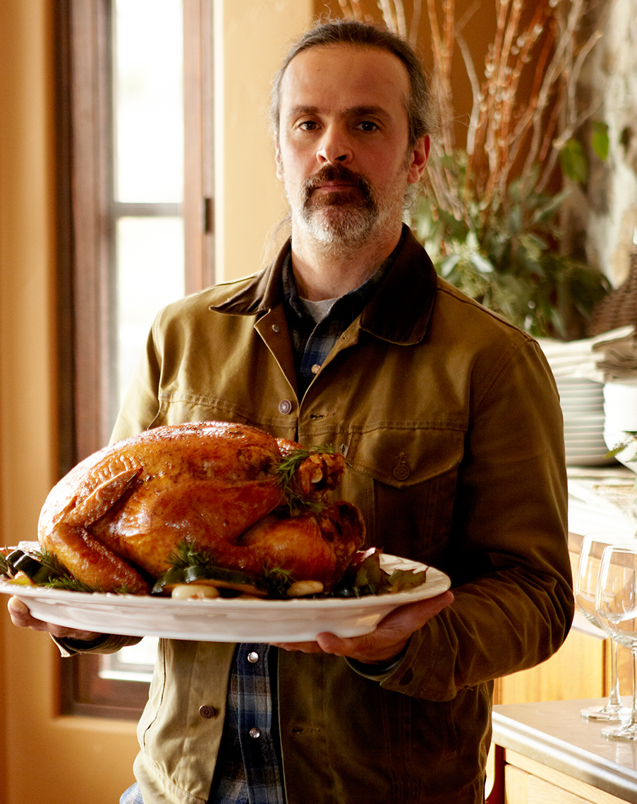 Rugged man holding Thanksgiving turkey