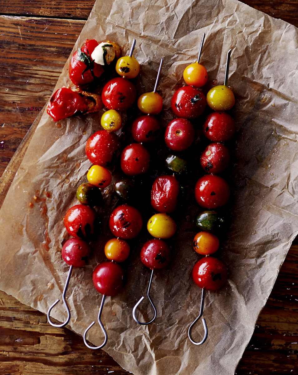 Grilled tomatoes on a skewer.