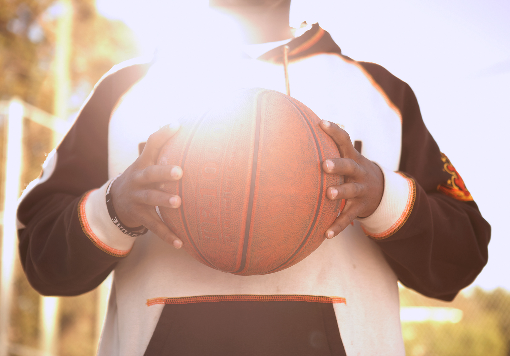 Teenager holding basketball