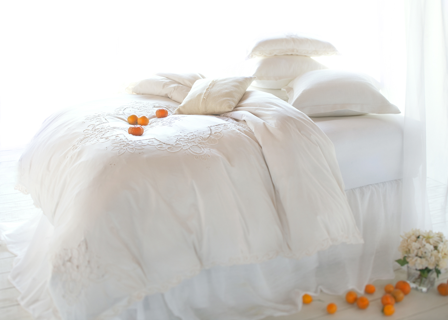 Bed in front of window with oranges