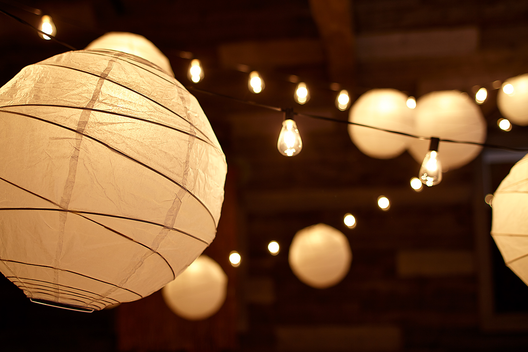 Lanterns hanging inside barn