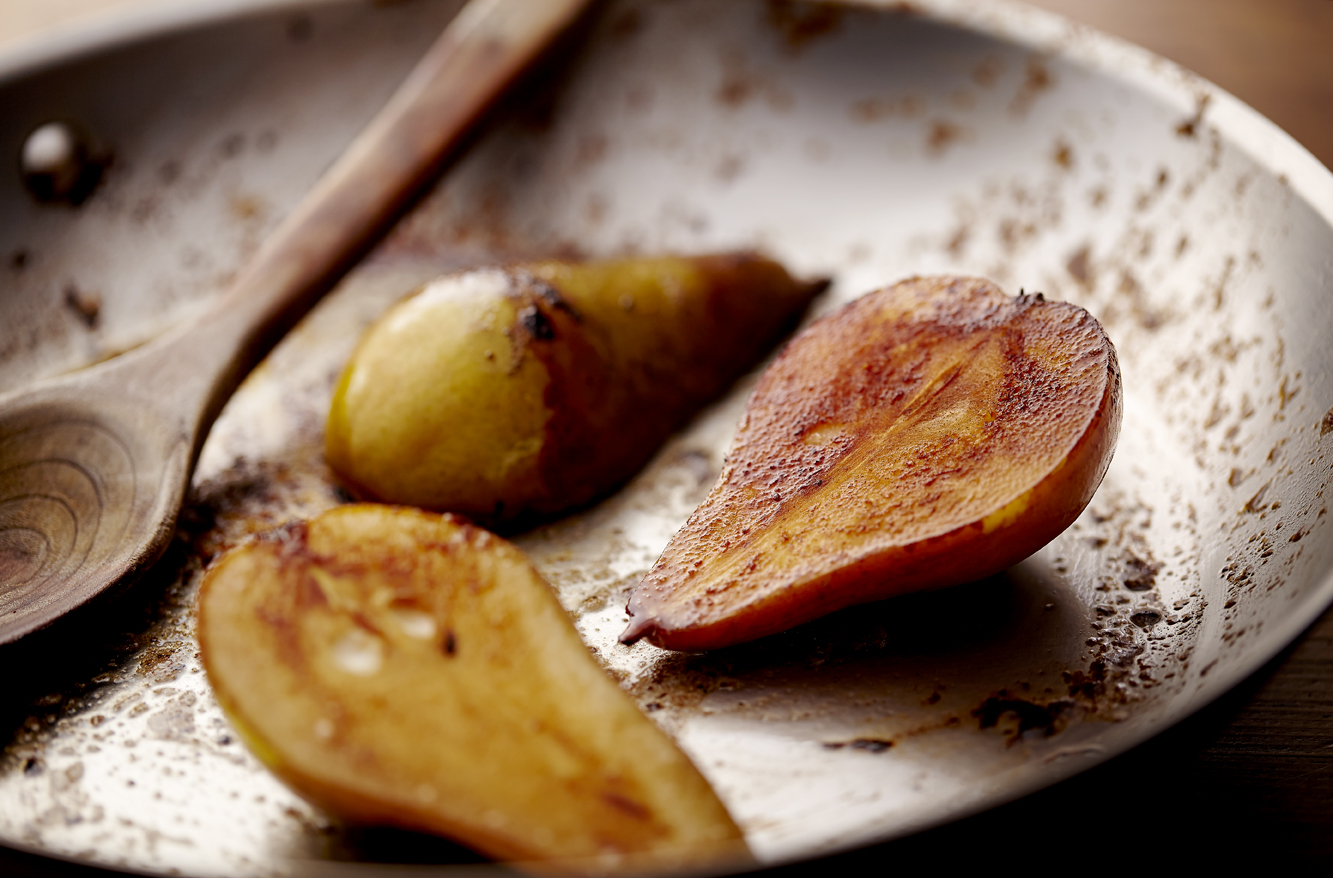 Sauteed pairs. Carmelized pears. Browned pairs. Pears in a saute pan.